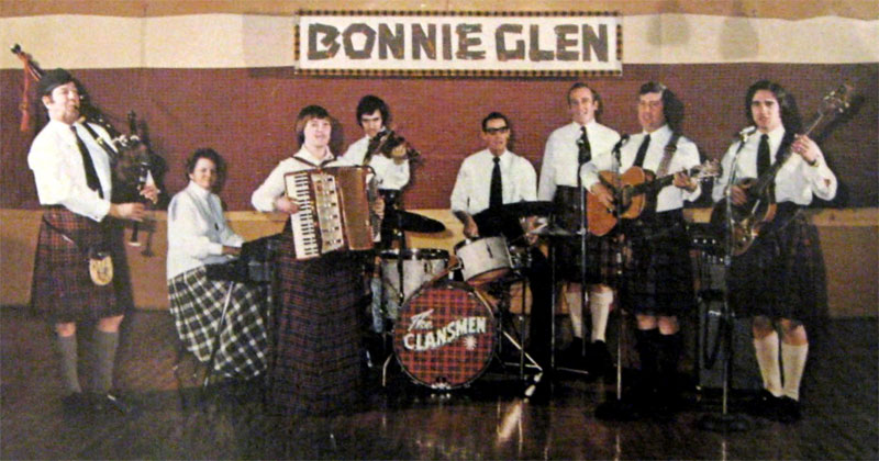 The Clansmen: Pipe Major John T. MacKenzie, Clara MacLeod, Thwyla MacDonald, Darryl McLeod, John Job, Sylvester MacDonald, Jack Smith and Lyle MacMillan.